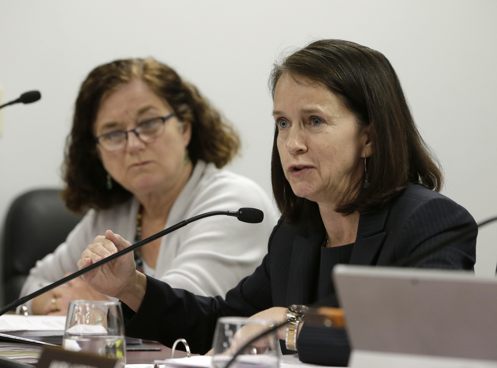 In this March 17, 2016 file photo, Jodi Remke, right, chairwoman of the Fair Political Practices Commission, discusses a proposed rule change to curb unreported lobbying, as commission member Patricia Wynne, left, looks on in Sacramento, Calif. California's top political watchdog is championing a bid to crack down on lobbyists who fail to disclose their efforts to influence government officials. The Fair Political Practices Commission is scheduled to consider a proposal Thursday, July 21, 2016, supported by commission chairwoman Remke, allowing state regulators to require suspected lobbyists to provide evidence showing whether they are paid to influence government officials.