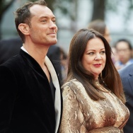 British actors Jude Law (L), US actress Melissa McCarthy (C), and British actor Jason Statham pose for photographs on the carpet as they arrive to attend the European premiere of the film 'Spy' in London on May 27, 2015.