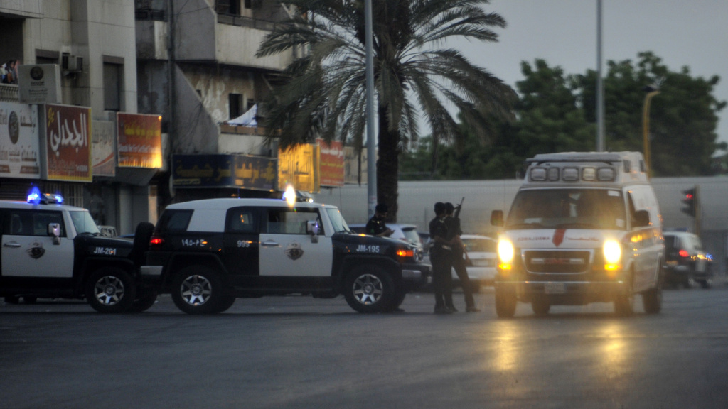 Saudi policemen stand guard at the site where a suicide bomber blew himself Monday, near the U.S. consulate in the Red Sea city of Jeddah.