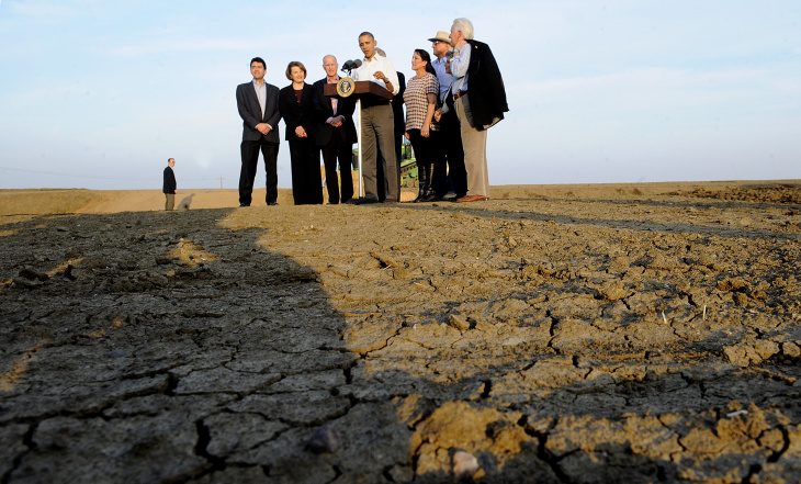 US President Barack Obama speaks to the media on California's drought situation on February 14, 2014 in Los Banos, California. Obama met with farmers and ranchers while pledging millions of dollars in federal funds for drought relief projects in California.