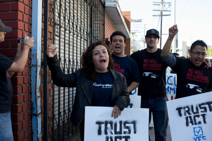 Veronica Martinez, 22, of Los Angeles are led away from the corner of Bauchet and Vignes where they were detained for unlawful assembly, Thursday, September 6, 2012 in Los Angeles Calif. A crowd of Trust Act supporters marched a short distance before stationing themselves on the corner in front of the Men's Central Jail in order to protest Sheriff Lee Baca and Secure Communities, which allows local police agencies to fingerprint and detain undocumented immigrants in jail.