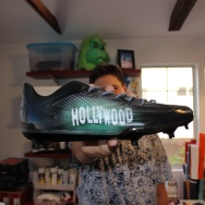 Wes Burton shows off one of his recent custom cleat creations.
