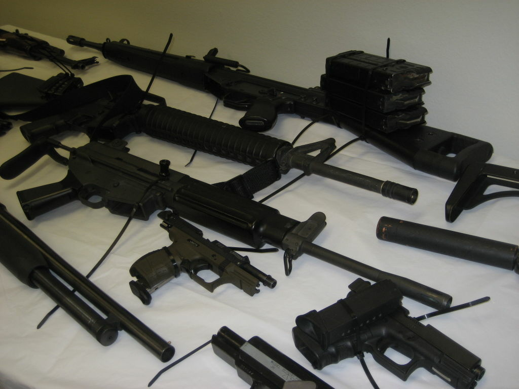 Federal authorities showcase some of the guns seized in a home and warehouse in Bell Gardens.  They accused members of the