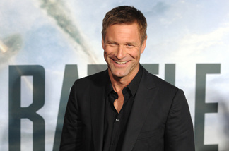 Actor Aaron Eckhart arrives at the premiere of 'Battle : Los Angeles' in Westwood, California on March 8, 2011.