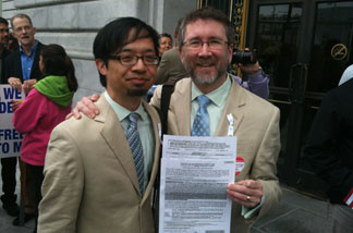 Couple Jeff Tabaco and Thom Watson stand on the steps outside San Francisco County Clerk's Office for a marriage license, with their application already filled out