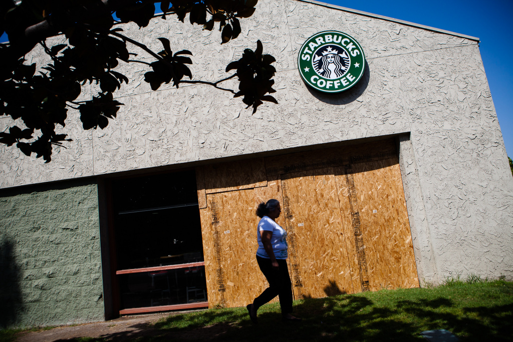 On July 31, 2012, wood still covers damage from recent protests at the Starbucks near Anaheim's City Hall. Members of the community took to the streets after two unrelated police killings of Latino youth on July 21 and 22nd.