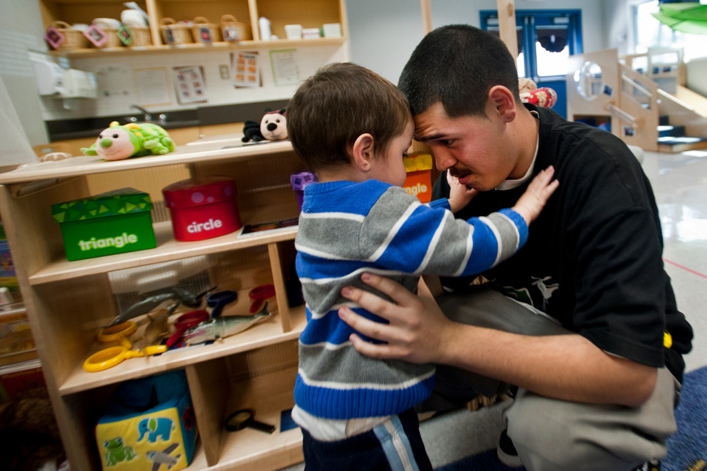 Roger Razo, 18, and his two-year-old son, Andrew, say goodbye after spending time at his daycare at North Park High School on Friday, March 8.