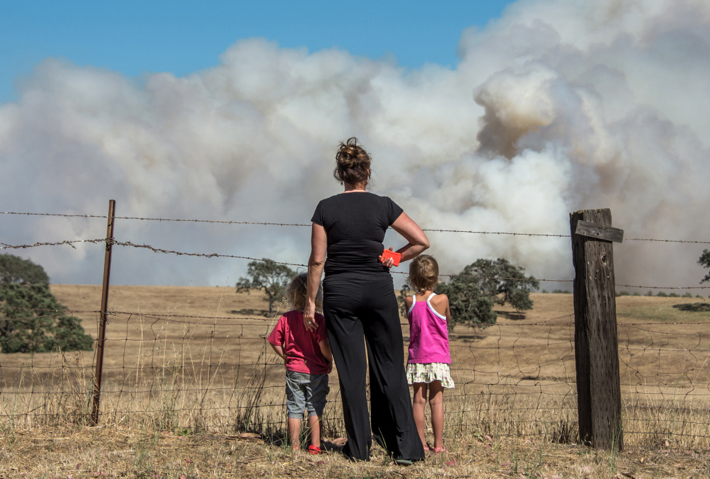 Local residents watch wildfire on May 28, 2013 north of Santa Barbara near Santa Ynez, California.