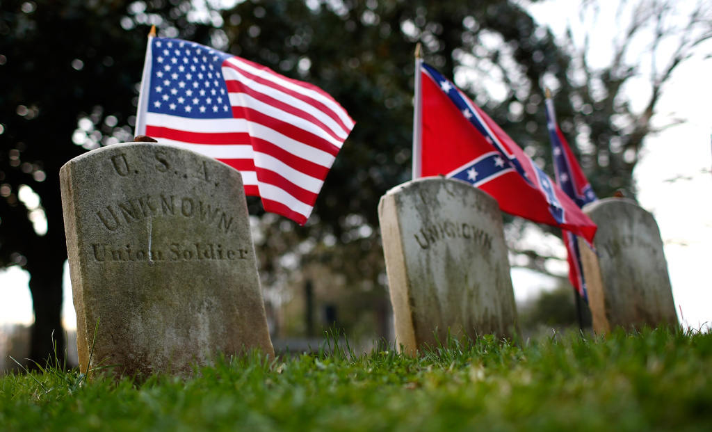 The graves of a Union soldier with Confederate soldiers are shown at sunset at the Appomattox Court House National Historical Park April 7, 2015 in Appomattox, Virginia. Today is the 150th anniversary of Confederate General Robert E. Lee's surrender of the Army of Northern Virginia to Union forces commanded by General Ulysses S. Grant in the McLean House at Appomattox, Virginia. The surrender marked the beginning of the end of the American Civil War in 1865. (Photo by Win McNamee/Getty Images)