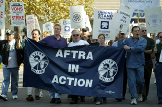 File photo: SAG President actress Melissa Gilbert and AFTRA President actor John Connolly, along with other SAG and AFTRA members, join striking UFCW Picket Lines supporting the striking grocery workers outside the Pavilions Market on December 4, 2003 in Burbank.
