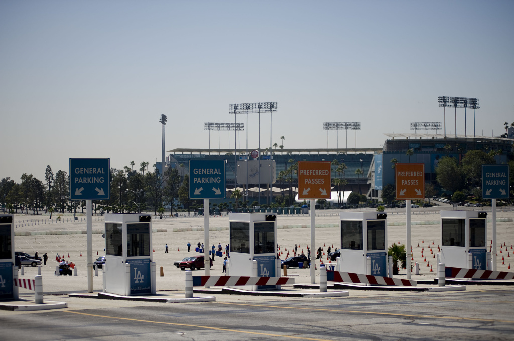 In this file photo, people wait in line at the Michael Jackson Memorial Service ticket pick-up area held at a parking lot at Dodger Stadium July 6, 2009 in Los Angeles, California. The price to park during Dodger games will increase from $10 to $15 if you pay at the gate, a spokesperson told KPCC on Friday, Feb. 14, 2014.