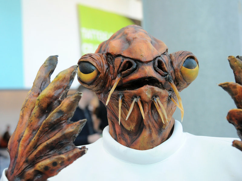 A cosplayer dressed as Admiral Ackbar poses at Disney's 2015 Star Wars Celebration in Anaheim.