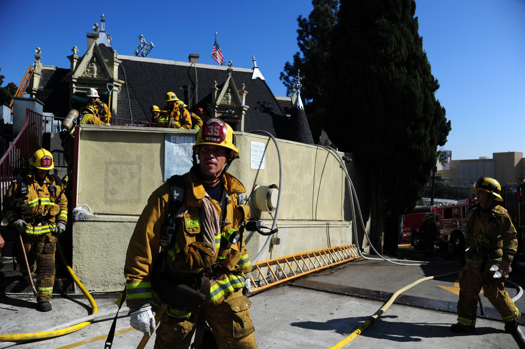 Firefighters work at the Magic Castle in Hollywood, California October 31, 2011.