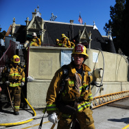 Firefighters work at the Magic Castle in