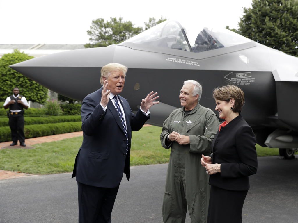 President Trump talks with Lockheed Martin president and CEO Marilyn Hewson and director and chief test pilot Alan Norman in front of a F-35 at the White House in July 2018.