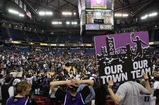 Fans of the Sacramento Kings hold up signs referencing the possible move to Anaheim in a game against the Los Angeles Lakers.