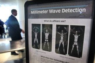 A sign informs travelers about Millimeter Wave Detection technology used in full body scanners at Midway Airport in Chicago, Illinois.