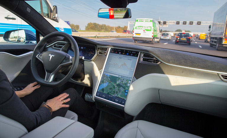 Interior of a Tesla A Tesla Model S, with its self-driving mode enabled.