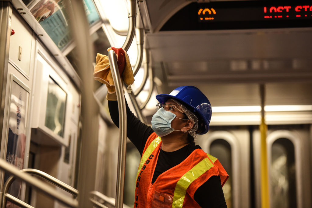 A cleaning crew disinfects a New York City subway train on May 4, 2020 in New York City.