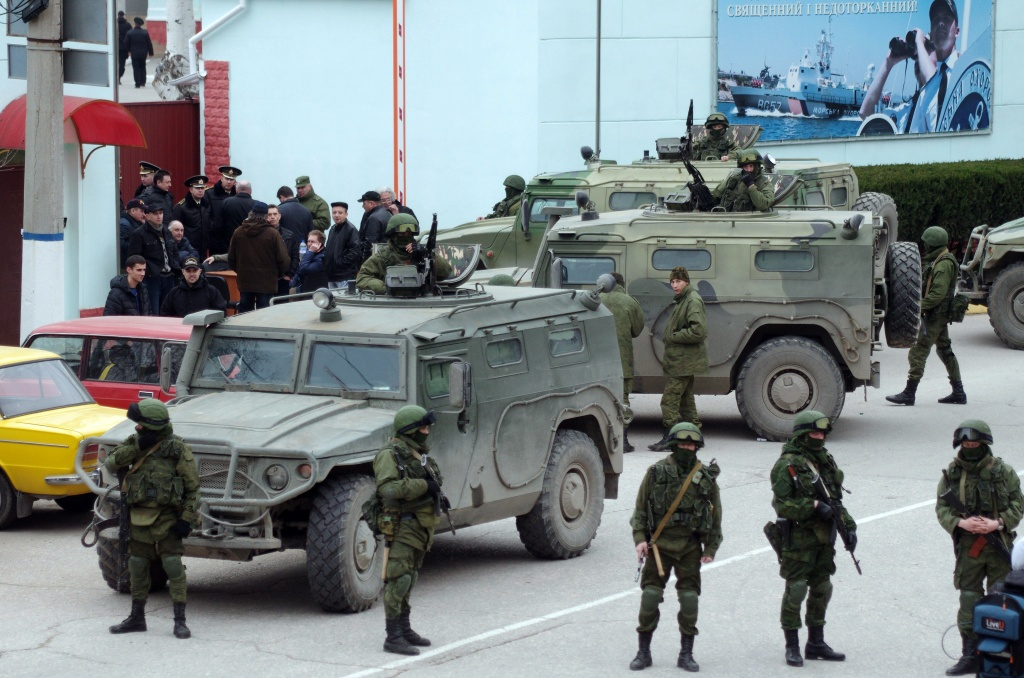 Unidentified armed individuals with armored vehicles block the base of the Ukrainian border guard service in Sevastopol, on March 1, 2014, near a sign (R) reading 'The border of the country is sacred and untouchable'. Ukraine's border guard service said on March 1 that about 300 armed men were attempting to seize its main headquarters in the Crimean port city of Sevastopol under orders from Russian Defence Minister Sergei Shoigu. 'The head of this group said that there are orders from the Russian defence minister to seize this naval post,' Ukraine's border guard service said in a statement, adding that the men wore 'full battle fatigues'.