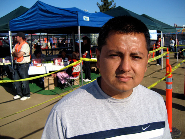 Yoshio Moncada stands in front of the Kern County Public Health Department's makeshift clinic at the swap meet on the county fairgrounds in Bakersfield, Calif. If the shots weren't available at the swap meet, Moncada says, he and his family wouldn't have gotten vaccinated.