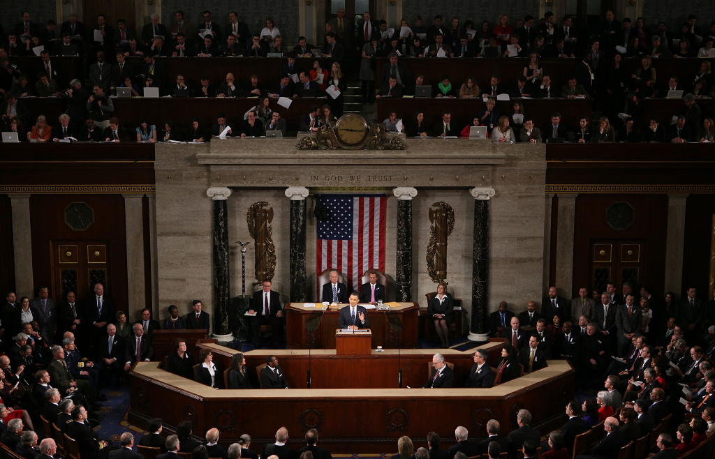 WASHINGTON, DC - JANUARY 25:  U.S. President Barack Obama, flanked by Vice President Joe Biden (L) and Speaker of the House John Boehner (R-OH), addresses a Joint Session of Congress while delivering his State of the Union speech January 25, 2011 in Washington, DC.