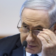 "Israeli Prime Minister Benjamin Netanyahu listens during a Cabinet meeting in Jerusalem on Sunday. His Cabinet approved a draft law that defines the country as ""the nation-state of the Jewish people."""