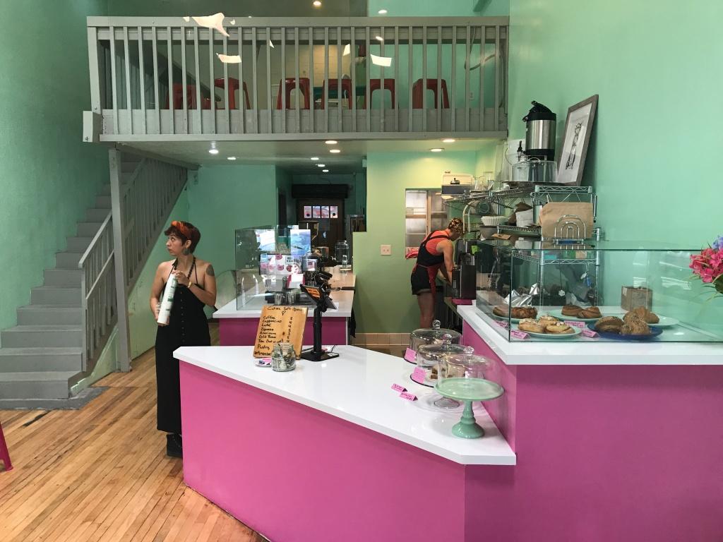 Co-owner Virginia Bauman and Carolina Fontoura-Alzaga restock the coffee bar at Cuties, just a few weeks after the shop opened.