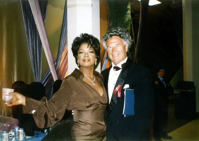 Notorious gate-crasher Dion Rich with Oprah Winfrey.