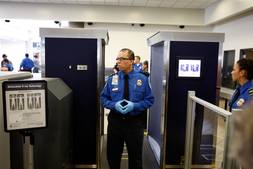 TSA agents stand near an Advanced Imaging Technology (AIT) full-body scanner at Los Angeles International Airport (LAX) on November 22, 2010 in Los Angeles.