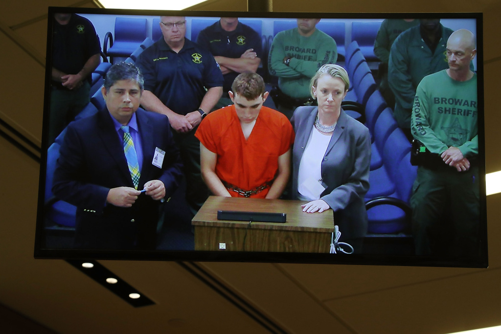 Nikolas Cruz, 19, a former student at Marjory Stoneman Douglas High School in Parkland, Florida, where he allegedly killed 17 people, is seen on a closed circuit television screen during a bond  hearing in front of Broward Judge Kim Mollica at the Broward County Courthouse on February 15, 2018 in Fort Lauderdale, Florida.