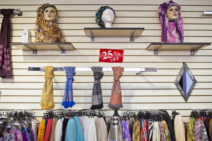 Hijabs are for sale at Al-Farah Islamic Fashion store in Anaheim. Local Arab American small business owners are hoping to get the city council to designate the neighborhood as