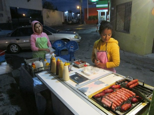 Two sisters prepare hot dogs near the central plaza in the town of Cuatro Cienegas. Most residents here are concerned about security in Mexico.