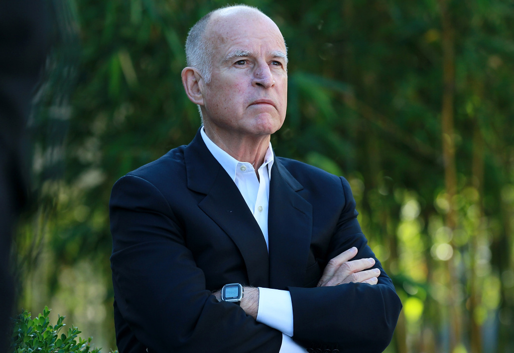 California governor Jerry Brown looks on during a ribbon cutting ceremony on October 19, 2011, in Santa Clara, California. Brown has proposed a new pension plan that is predicted to save $900 million in revenue.