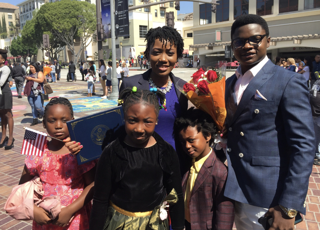 Pauline Anubondem, 24, with her family after the Cameroon native was sworn in as a U.S. citizen.