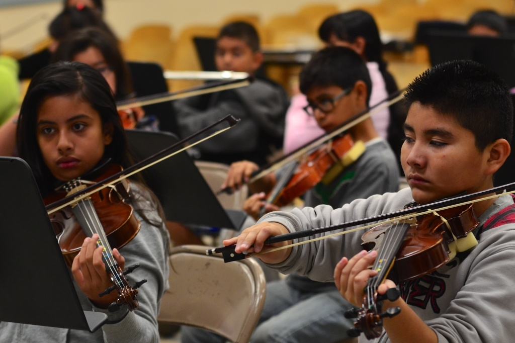 File: Advanced violin students play their instruments at San Fernando Elementary.