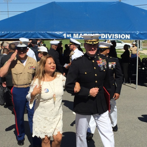 Rosa Peralta is escorted following a ceremony awarding her son Rafael the United States Marine Corps' second-highest valor award: the Navy Cross. Her son was killed in Iraq in November 2004.