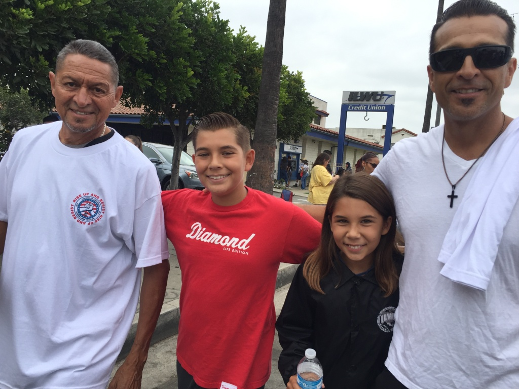 Longshoreman Bobby Carrillo with his son and grandchildren at the Labor Day parade in Wilmington.