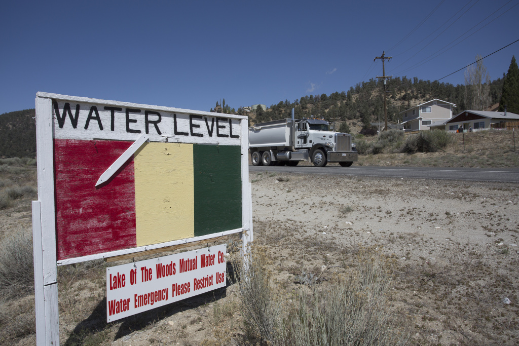 A ground water level sign emphasizes the urgency of a drought-related water supply emergency in the community of Lake of the Woods in Los Padres National Forest near Frazier Park, California.