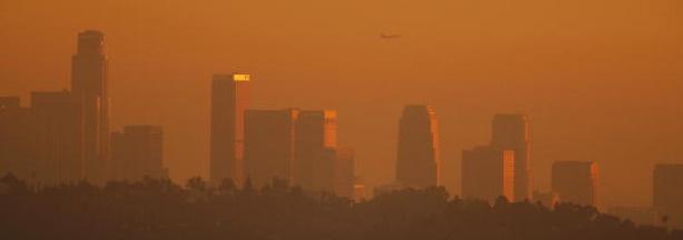 The Los Angeles downtown skyline is enveloped in smog shortly before sunset