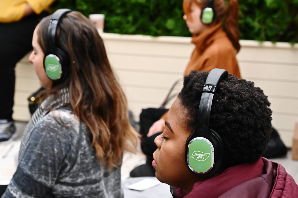 Guests join a guided meditation lead by MNDFL instructor at Winter Wellness Retreat by Nature's Way at POPSUGAR's first-ever Sugar Chalet Winter Wonderland In Bryant Park on November 23, 2019 in New York City.