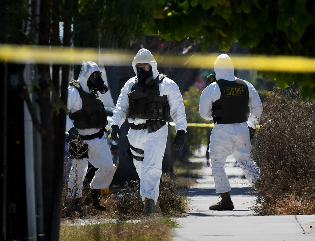 Members of the Los Angeles County Sheriff's Department bomb and hazmat squad search a Lawndale house where several artillery shells and grenades were found on September 29, 2017.