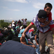Central American migrants arrive on top of a freight train for a stop on August 6, 2013 in Ixtepec, Mexico, en route to the United States. House GOP lawmakers have agreed to vote this week on a pared-down bill to address the Central American migration crisis that has brought large numbers of unaccompanied minors and families to the U.S.-Mexico border. The bill would provide far less funding than the $3.7 billion initially requested by President Obama.