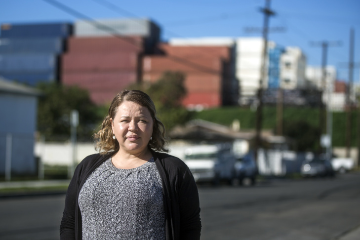 Magali Sanchez Hall and her family have lived in this neighborhood in Wilmington for 20 years. Sanchez Hall stands on Sanford Avenue in front of New Hope Baptist Church and a shipping container storage yard near her home on Tuesday afternoon, Jan. 31, 2017.