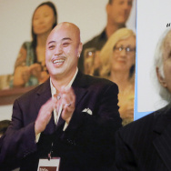 "FILE - In this April 10, 2014 file photo, Tony Serra, right, former attorney for Raymond Chow, known as ""Shrimp Boy,"" pictured at left, listens to speakers at a news conference in San Francisco. A federal judge on Thursday, Aug. 4, 2016, sentenced the San Francisco Chinatown gang leader known as ""Shrimp Boy"" to two life sentences, one for killing a rival, in a wide-ranging organized crime investigation that also brought down a state senator. (AP Photo/Jeff Chiu, File)"