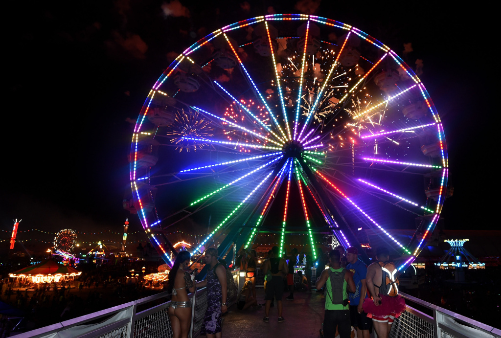 Fireworks explode behind a Ferris wheel at the 18th annual Electric Daisy Carnival at Las Vegas Motor Speedway on June 22, 2014 in Las Vegas, Nevada.