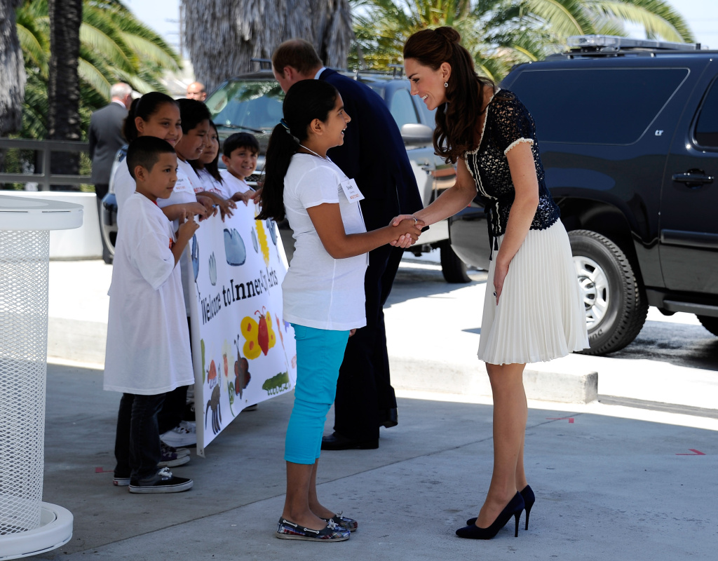 Sneh Chachra a student of Inner City Arts greets Catherine, Duchess of Cambridge after she arrived with her husband Prince William, Duke of Cambridge, for a tour of the school on July 10, 2011 in the Skid Row section of Los Angeles.