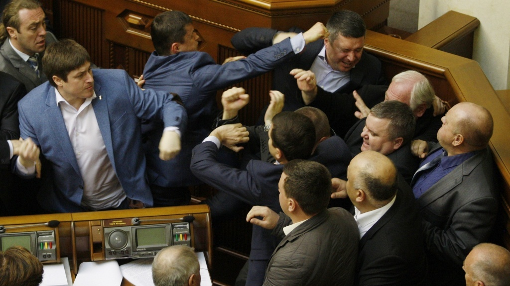 Members of Ukraine's Svoboda party fight with members of the Communist Party in the Ukraine's parliament Tuesday, during a debate over a law toughening responsibility for separatism.