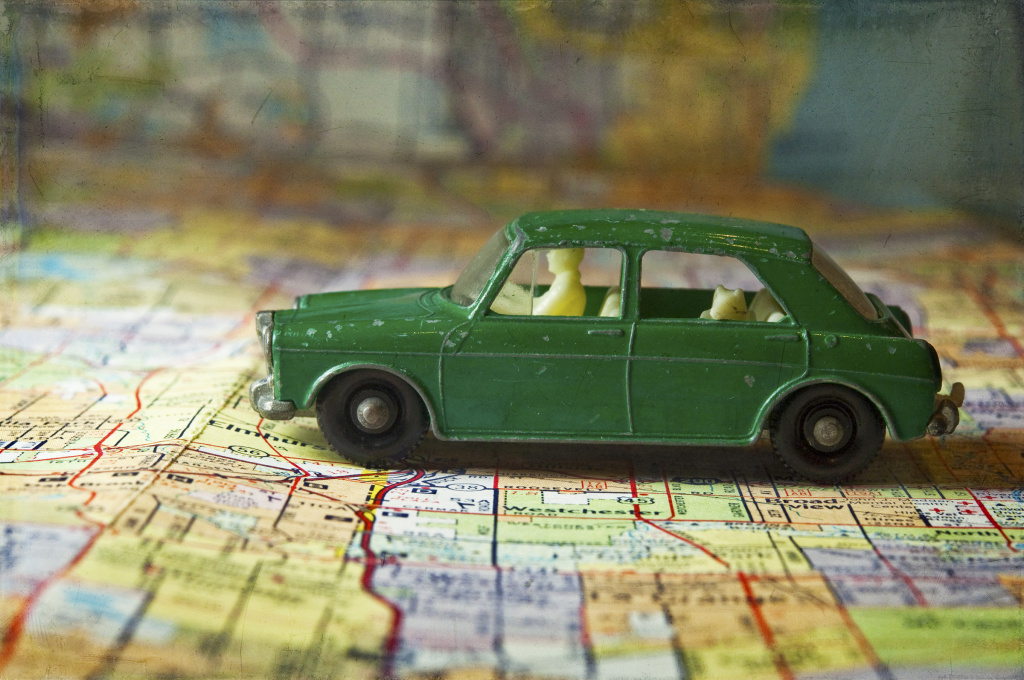 File: A toy car sits on a map.