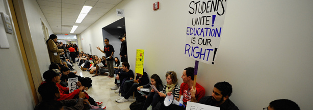 Students and faculty members stage a sit-in in front of the school president's office at California State University, Northridge demonstrating against proposed budget cuts at all 23 Cal State University campuses statewide on April 13, 2011.